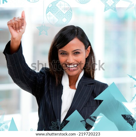 Successful businesswoman with a thumb up standing against christmas frame