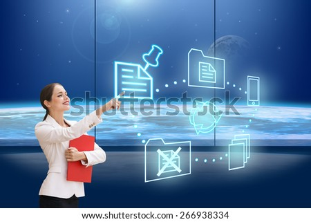 Successful businesswoman with red folder making use of innovative technologies - stock photo