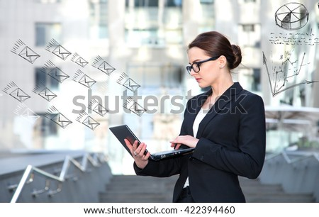 Successful businesswoman working at laptop. Business woman in glasses working on-line. Network marketing. Receiving spam emails - stock photo