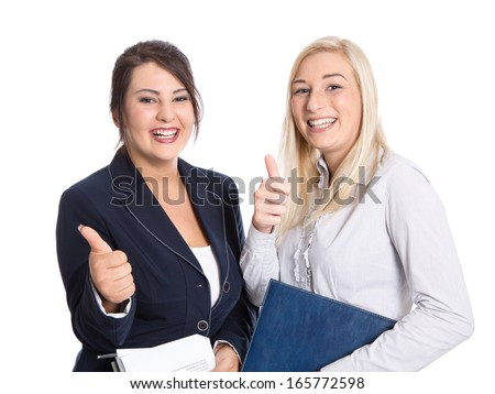 Successful bussineswomen thumbs up and smiling on white - stock photo