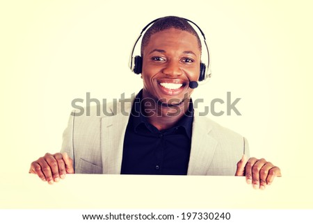 Successful call center worker with blank board. - stock photo