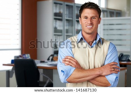 Successful casual business man at office - stock photo