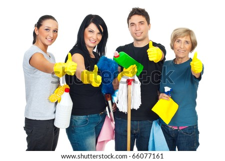 Successful cleaning people teamwork giving thumbs up and holding products for clean house - stock photo