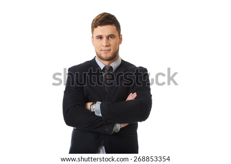 Successful confident businessman with folded arms. - stock photo