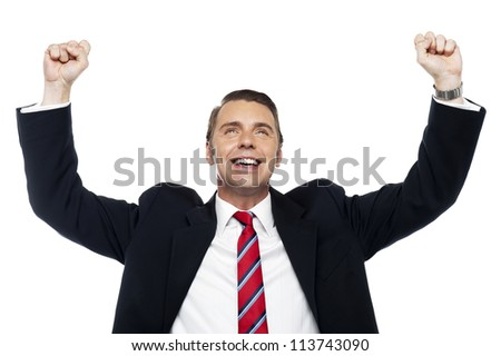 Successful corporate male, arms raised in excitement