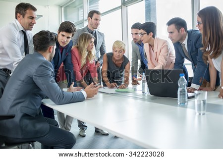 successful corporate people having a business meeting in office
