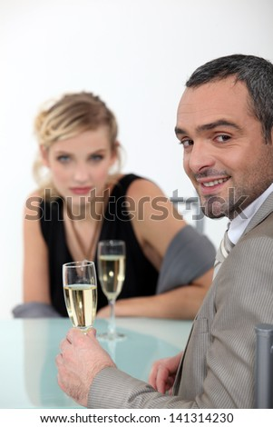 Successful couple toasting with champagne - stock photo