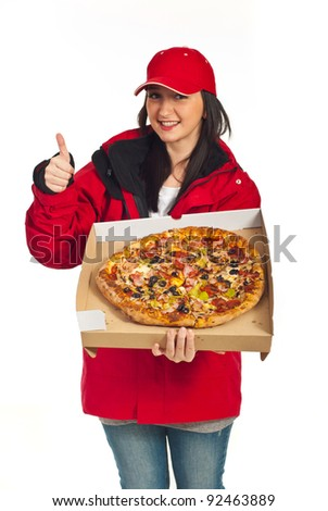 Successful  delivery worker woman giving thumb up and showing big pizza ,selective focus on pizza,isolated on white background