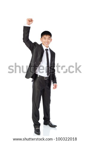 successful excited asian young business man hold fist, full length portrait of businessman with raised arm hand up, isolated over white background