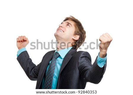 Successful excited business man happy smile looking up to empty copy space hold fist, handsome young businessman with arms wide open, wear elegant suit and tie isolated over white background - stock photo