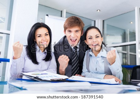 Successful excited Business people group team, young businesspeople smile hold fist ok yes gesture with raised hands arms at office desk