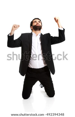 Successful excited businessman making fists.