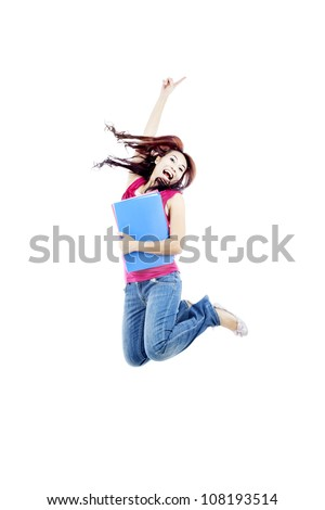Successful female college student jumping on white background to celebrate her success - stock photo