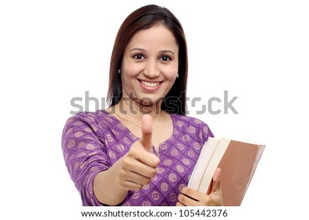 Successful female student with thumbs up gesture