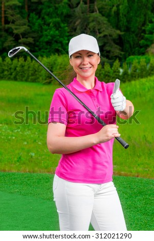 successful golfer happy woman standing with a golf club - stock photo