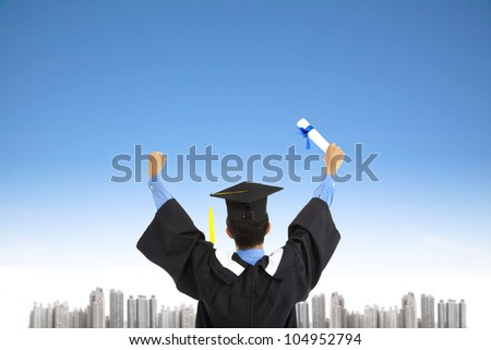 successful graduating student with sky background - stock photo