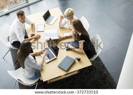 Successful group of business people working on plans - stock photo