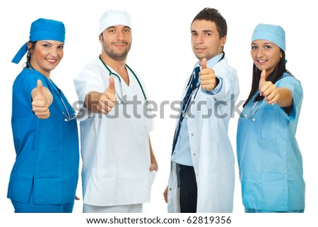 Successful group of four doctors giving thumbs up in a row isolated on white background - stock photo