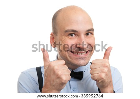 successful handsome bald man showing his thumbs up - stock photo