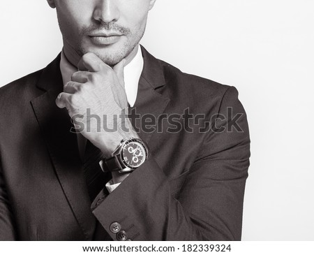 Successful handsome businessman smiling. - stock photo