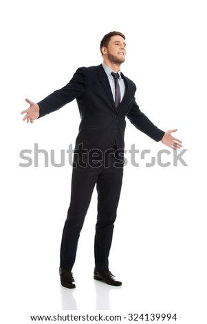 Successful handsome businessman with open hands. - stock photo