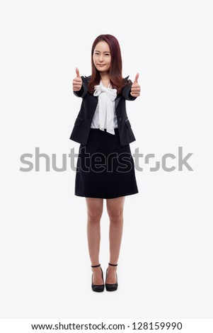 Successful happy Asian businesswoman showing thumb isolated on white background.