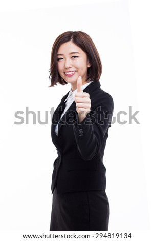 Successful happy Asian businesswoman showing thumb isolated on white background.  - stock photo