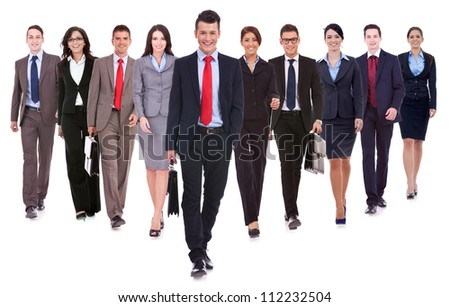 Successful happy business team walking towards the camera on white background - stock photo