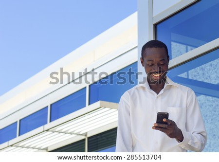 Successful happy  Businessman looking cellphone near modern office  - stock photo