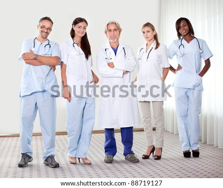 Successful happy group of doctors with stethoscope at the hospital