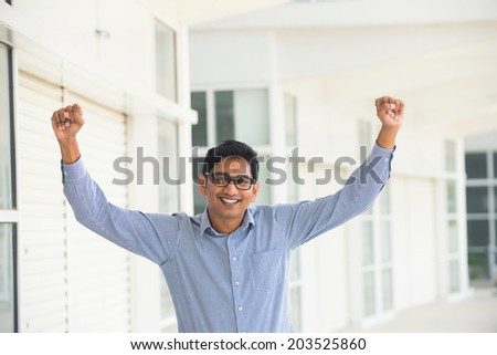 successful indian business man expressing in office outdoor - stock photo
