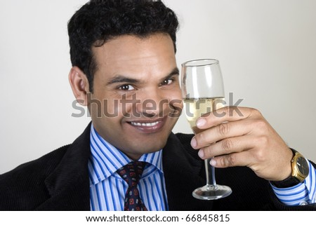 successful indian man toasting - stock photo