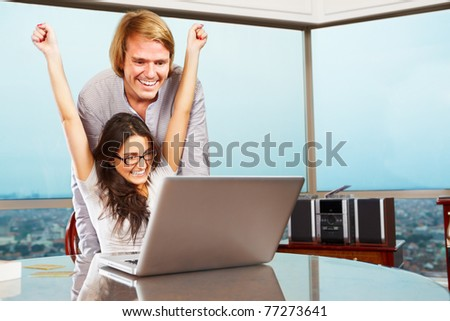 Successful lady expressing her happiness with her spouse behind him