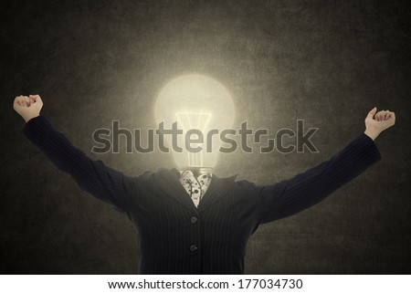Successful lamp head businesswoman with arms up - stock photo