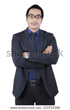 Successful male manager wearing formal suit looking at the camera in the studio - stock photo
