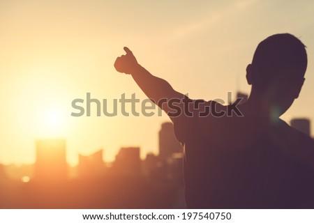 Successful Man aiming at Sunset - stock photo
