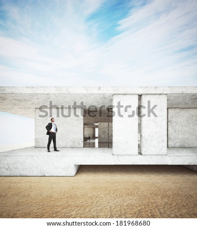 Successful man and his contemporary luxury house on a beach - stock photo