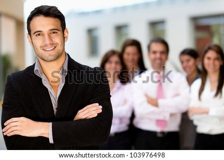Successful man at the office leading a business team