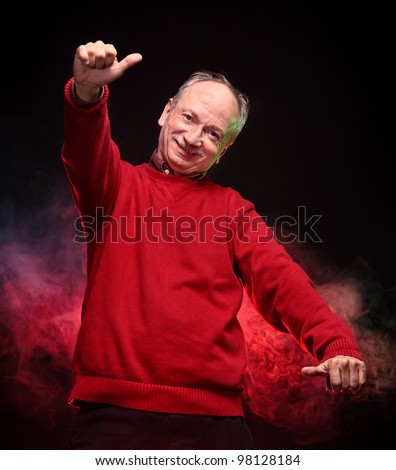 Successful man in a red sweater shows ok sigh - stock photo