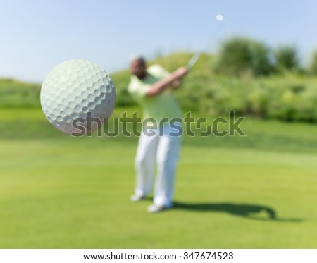 Successful man playing golf at club