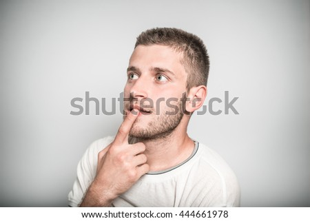 successful man remembered something important, isolated on a gray background - stock photo