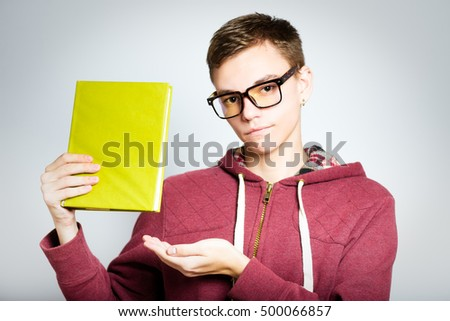 successful man shows the book isolated on a gray background