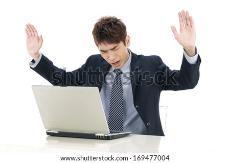 Successful man with a laptop - online business concepts - stock photo