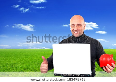 Successful man with a piggybank in his hand - stock photo