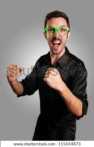 successful man with green eyeglasses on gray background