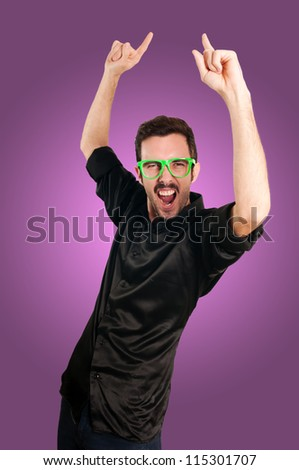 successful man with green eyeglasses on pink background