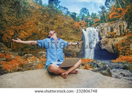 successful man with laptop outdoors - stock photo