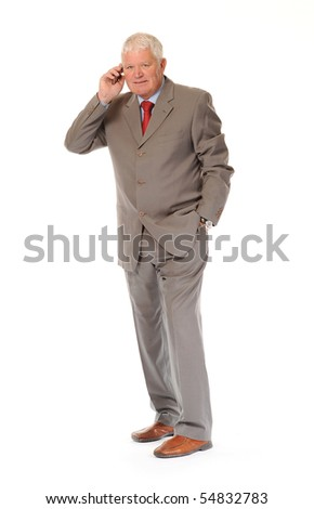 Successful mature business man on white background, using a cellphone or mobile