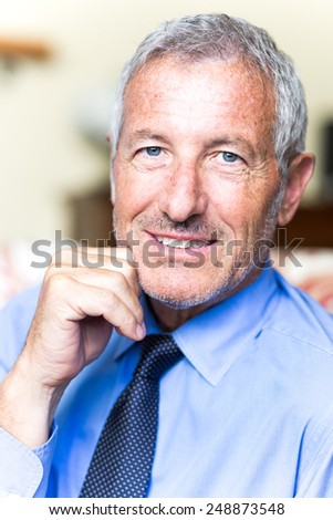 Successful mature handsome businessman looking confident - stock photo
