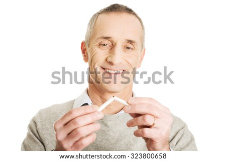 Successful mature man quits smoking - stock photo